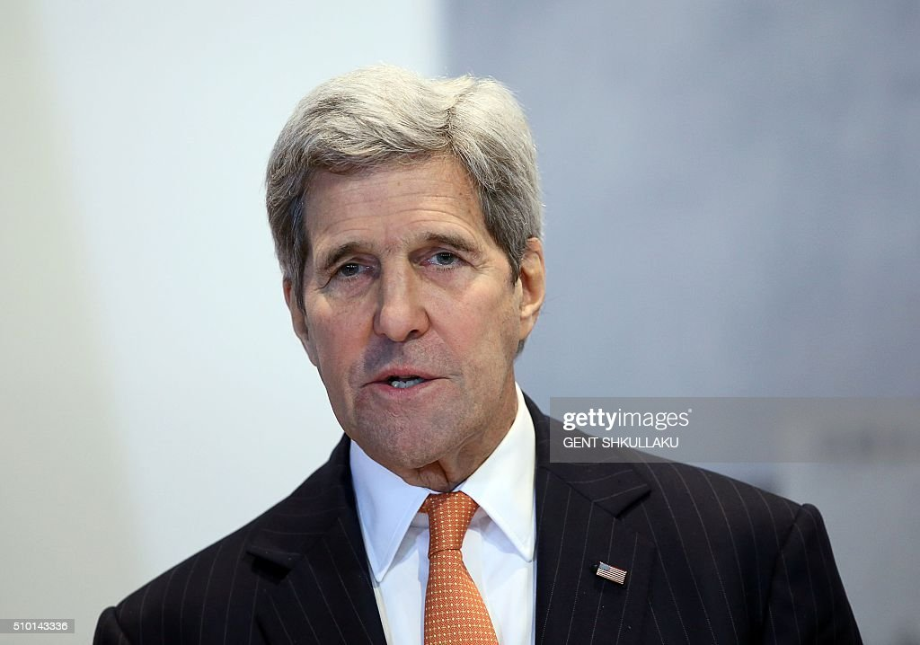 US Secretary of State John Kerry speaks during a media statement in Tirana on February 14, 2016. US Secretary of State is in a few hours visit to Tirana, to meet with senior government leaders to discuss Albanias further Euro-Atlantic integration and strong bilateral cooperation with the United States. / AFP / GENT SHKULLAKU