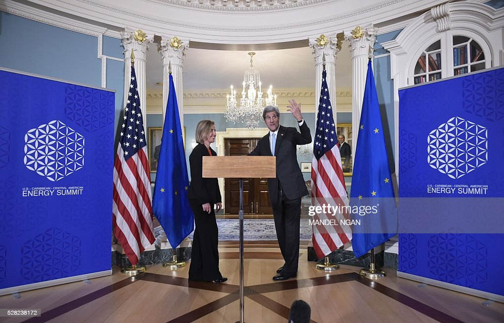 US Secretary of State John Kerry (R) speaks during a meeting with European Union Foreign Affairs and Security Policy High Representative Federica Mogherini at the State Department on May 4, 2016. / AFP / MANDEL