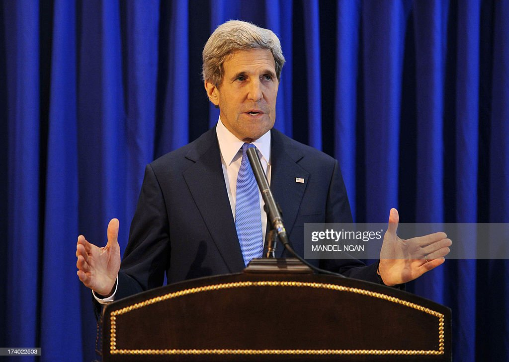 US Secretary of State John Kerry speaks during a press conference at Queen Alia International Airport on July 19, 2013. Kerry held the press conference following a meeting with Palestinian President Mahmud Abbas in the West Bank city of Ramallah. AFP PHOTO/Mandel NGAN