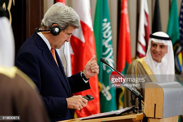US Secretary of State John Kerry speaks near Saudi Arabia's Foreign Minister Adel alJubeir during a joint press conference after the ministerial...
