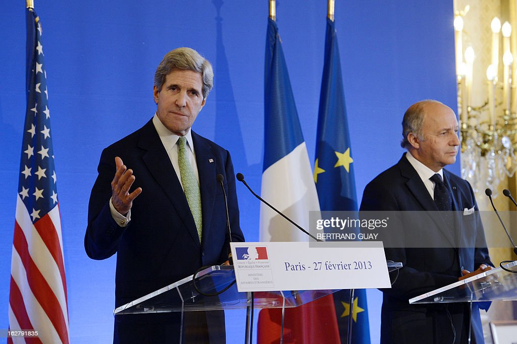 U.S. Secretary of State John Kerry (L) speaks next to French Minister of Foreign Affairs, Laurent Fabius, during a press conference on February 27, 2013 at the Foreign Ministry in Paris. Kerry began on February 24 a marathon tour of allies in Europe and the Middle East. AFP PHOTO BERTRAND GUAY
