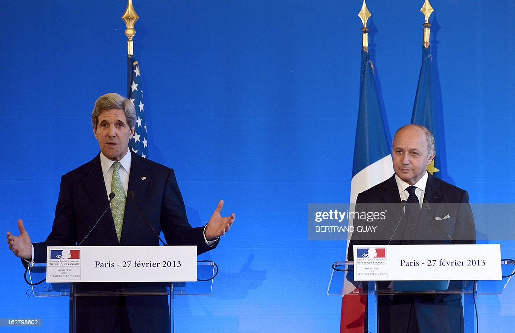 US Secretary of State John Kerry (L) speaks next to French Minister of Foreign Affairs Laurent Fabius, during a press conference on February 27, 2013 at the Foreign Ministry in Paris. Kerry began on February 24 a marathon tour of allies in Europe and the Middle East. AFP PHOTO BERTRAND GUAY