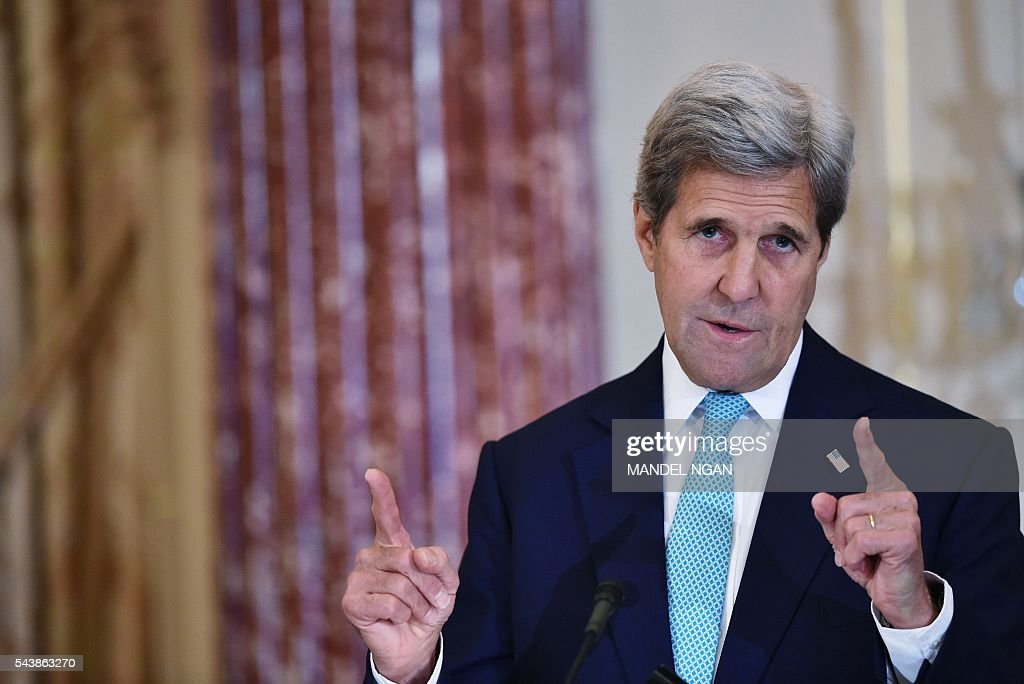 US Secretary of State John Kerry speaks regarding the 2016 Trafficking in Persons Report on June 30, 2016 at the State Department in Washington, DC . / AFP / Mandel NGAN