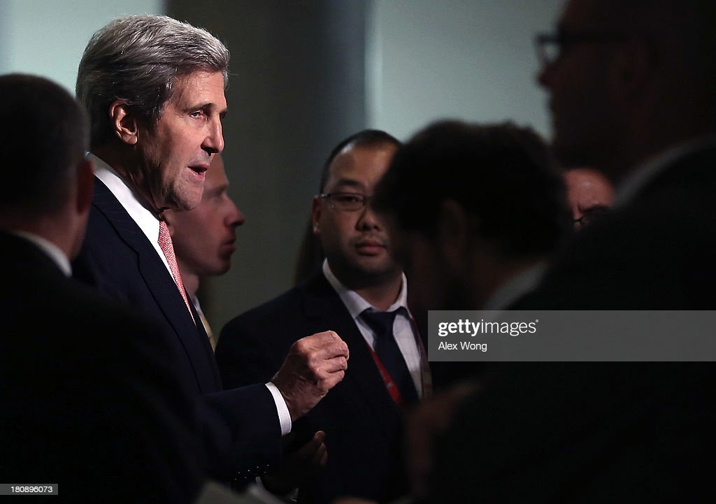 U.S. Secretary of State <a gi-track='captionPersonalityLinkClicked' href=/galleries/search?phrase=John+Kerry&family=editorial&specificpeople=154885 ng-click='$event.stopPropagation()'>John Kerry</a> speaks to members of the media as he arrives for a closed briefing on Syria before the Senate Foreign Relations Committee September 17, 2013 on Capitol Hill in Washington, DC. A team of UN inspectors found out a nerve gas attack against civilians did happen last month in Syria, according to the report they released to the UN Security Council on Monday.