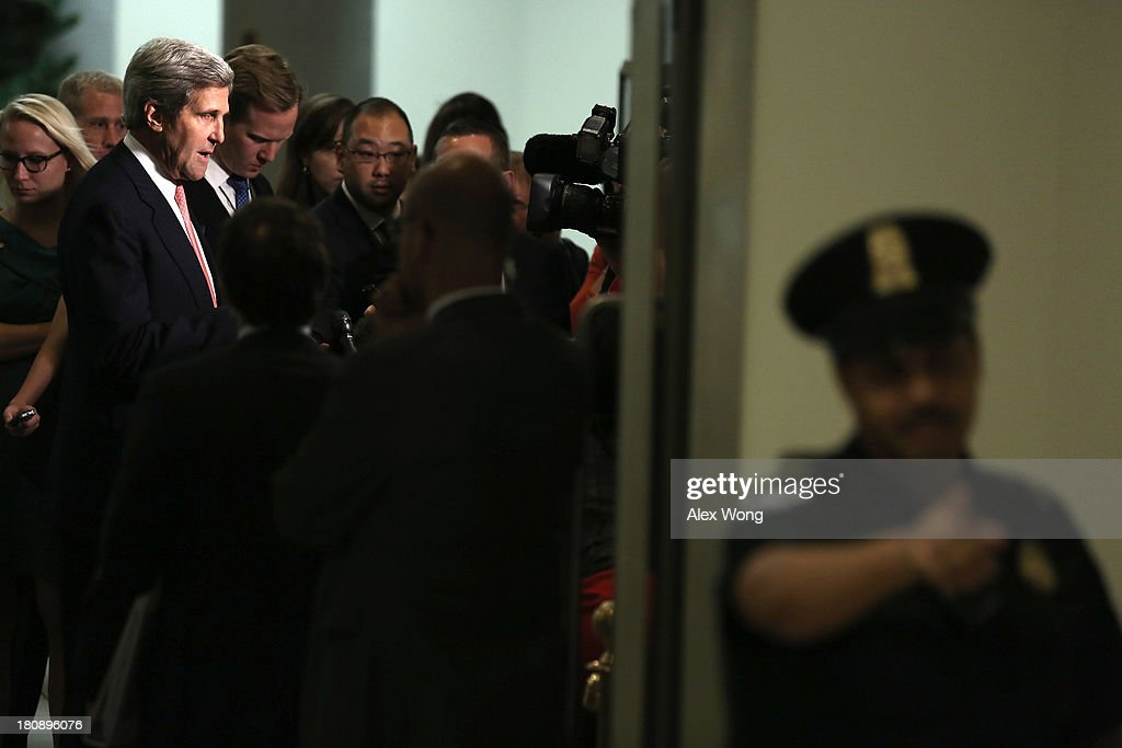 U.S. Secretary of State John Kerry speaks to members of the media as he arrives for a closed briefing on Syria before the Senate Foreign Relations Committee September 17, 2013 on Capitol Hill in Washington, DC. A team of UN inspectors found out a nerve gas attack against civilians did happen last month in Syria, according to the report they released to the UN Security Council on Monday.