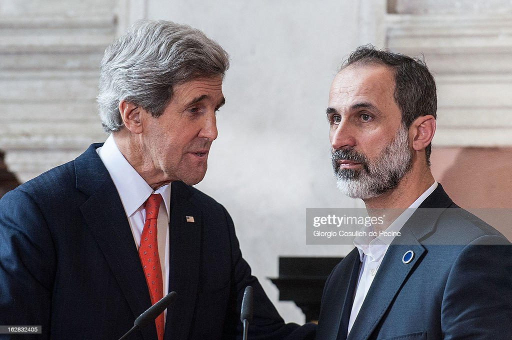 US Secretary of State <a gi-track='captionPersonalityLinkClicked' href=/galleries/search?phrase=John+Kerry&family=editorial&specificpeople=154885 ng-click='$event.stopPropagation()'>John Kerry</a> (L) speaks to Syrian opposition's National Coalition chief Ahmed Moaz al-Khatib during a press conference after the meeting of the 'Friends of the Syrian People' at Villa Madama on February 28, 2013 in Rome, Italy. Kerry stated that the opposition needs 'more help' in the fight against President Bashar Hafez al-Assad. The new US Secretary of State is on his first trip and is visiting nine nations in Europe and the Middle East.