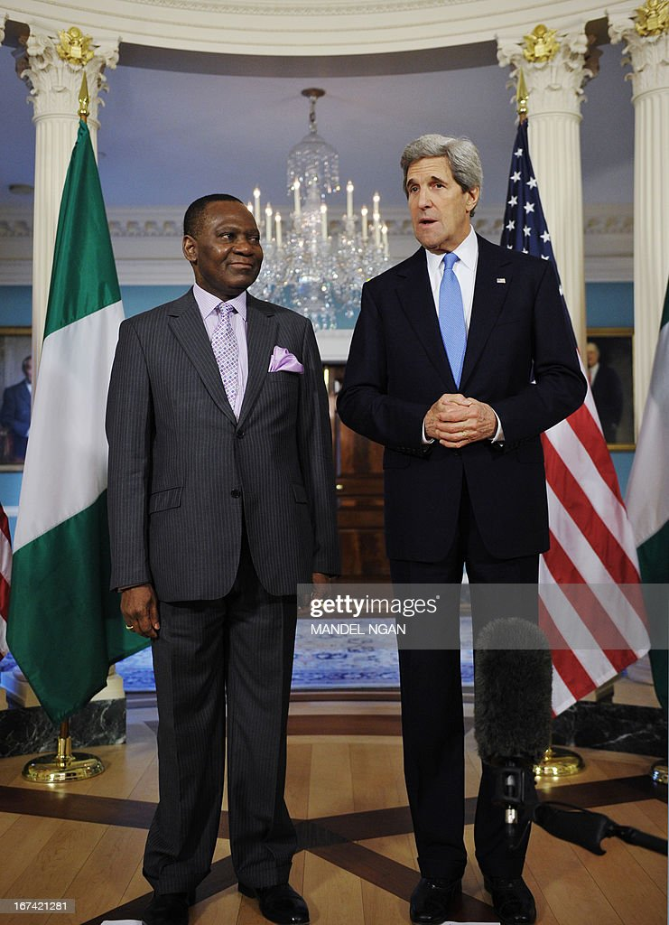 US Secretary of State John Kerry speaks to the press ahead a bilateral meeting with Nigeria's Foreign Minister Olugbenga Ashiru (L) on April 25, 2013 at the State Department in Washington, DC. AFP PHOTO/Mandel NGAN
