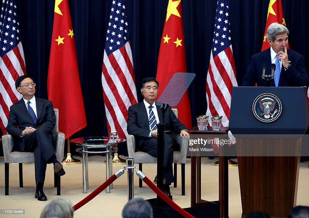 U.S. Secretary of State John Kerry speaks while Chinese State Councilor Yang Jiechi (L), and Chinese Vice Premier Wang Qishan (2nd-L), listen during the opening session of the U.S. and China Strategic and Economic Dialogue at the U.S. Department of State July 10, 2013 in Washington, DC. Officials from the United States and China are meeting in Washington for the 5th U.S. and China Strategic and Economic Dialogue.