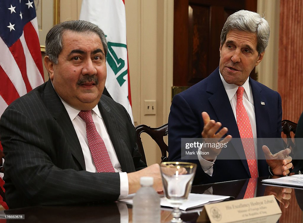 Secretary of State <a gi-track='captionPersonalityLinkClicked' href=/galleries/search?phrase=John+Kerry&family=editorial&specificpeople=154885 ng-click='$event.stopPropagation()'>John Kerry</a> (R) speaks while flanked by Iraqi Foreign Minister <a gi-track='captionPersonalityLinkClicked' href=/galleries/search?phrase=Hoshyar+Zebari&family=editorial&specificpeople=227333 ng-click='$event.stopPropagation()'>Hoshyar Zebari</a> during a meeting at the State Department August 15, 2013 in Washington, DC. Secretary Kerry spoke during the U.S.-Iraq Diplomatic and Political Joint Coordinating Committee meeting.