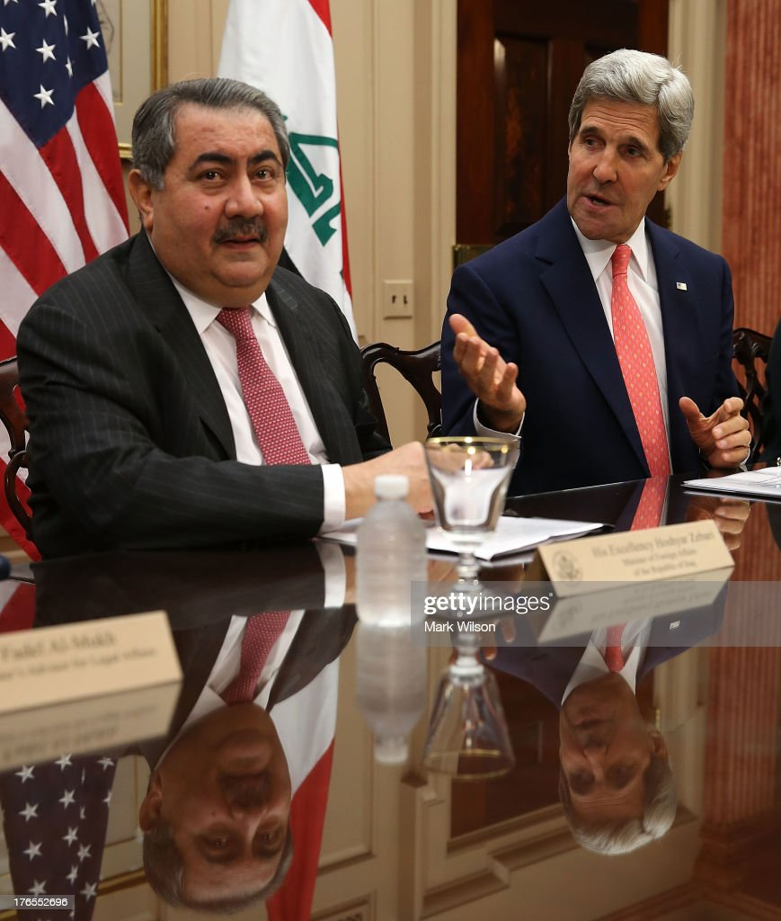 Secretary of State John Kerry speaks while flanked by Iraqi Foreign Minister Hoshyar Zebari during a meeting at the State Department August 15 2013...