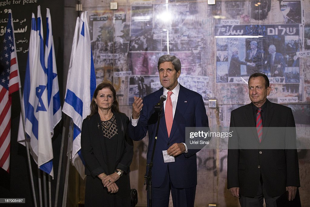 U.S. Secretary of State John Kerry (C) speaks while standing next to Dalia Rabin-Pelossof (L), daughter of assassinated Israeli Prime Minister Yitzhak Rabin and the Tel Aviv Mayor Ron Holdai during a memorial service at the site Israel's former Prime Minister Yitzhak Rabin's assassination on November 05, 2013 in Tel Aviv, Israel. Kerry is in the region to meet with both the Isaeli and Palestinian leaders.