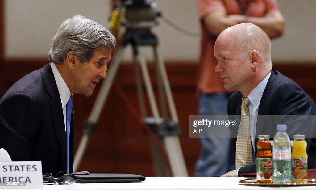 U.S. Secretary of State John Kerry (L) speaks with Britain's Foreign Secretary William Hague during the 'Friends of Syria' meeting in Amman, Jordan on May 22, 2013. The gathering seeks to discuss US-Russian proposal to hold a peace conference dubbed 'Geneva 2' to bring together rebels and representatives of Syrian President's regime.
