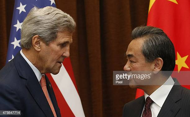 S Secretary of State John Kerry speaks with Chinese Foreign Minister Wang Yi prior to their meeting on May 16 2015 in Beijing China Kerry was to meet...