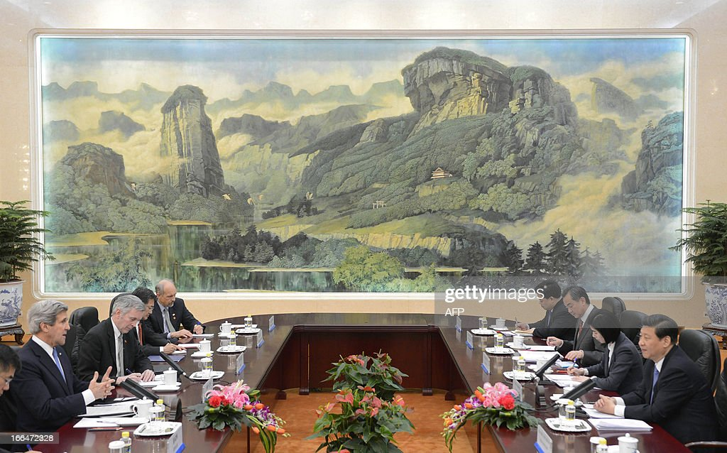 US Secretary of State John Kerry (2nd L) speaks with Chinese President Xi Jinping (R) during their meeting at the Great Hall of the People in Beijing on April 13, 2013. The current situation on the Korean peninsula is at a 'critical time', US Secretary of State John Kerry told Chinese President Xi Jinping on April 13 as he arrived to seek Beijing's intervention in the crisis.