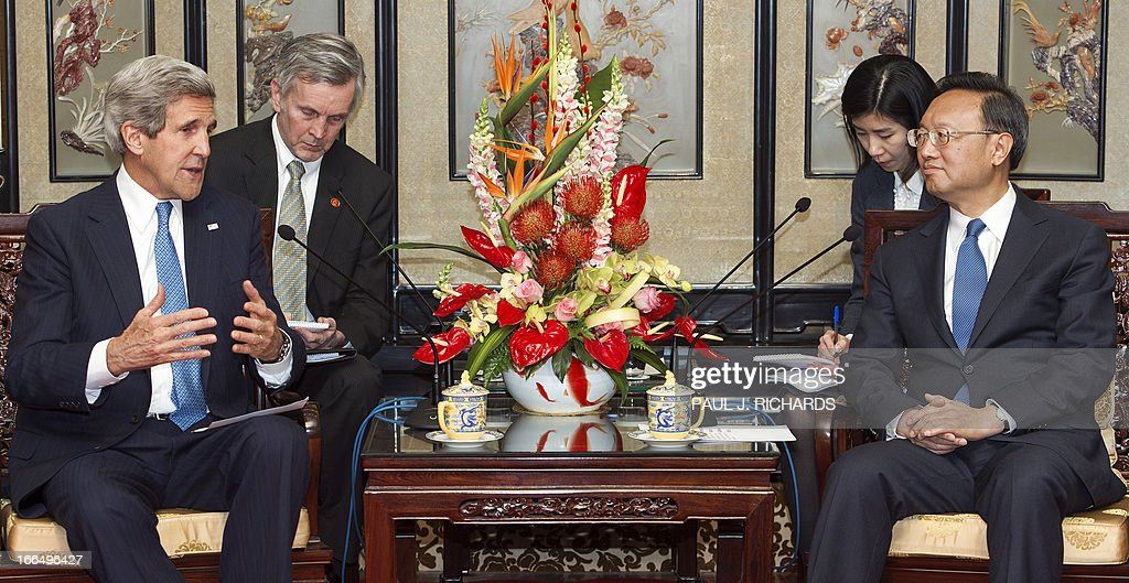 US Secretary of State John Kerry (L) speaks with Chinese state councilor Yang Jiechi (R) during a meeting at the Diaoyutai State Guesthouse in Beijing on April 13, 2013. US Secretary of State John Kerry on April 13 pressed North Korea's patron China to help defuse sky-high nuclear tensions, telling President Xi Jinping the world was facing a 'critical' moment. AFP PHOTO / POOL / Paul J. Richards