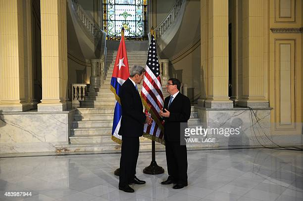 US Secretary of State John Kerry speaks with Cuban Minister of Foreign Relations Bruno Rodriguez Parrilla during a meeting in Havana on August 14...