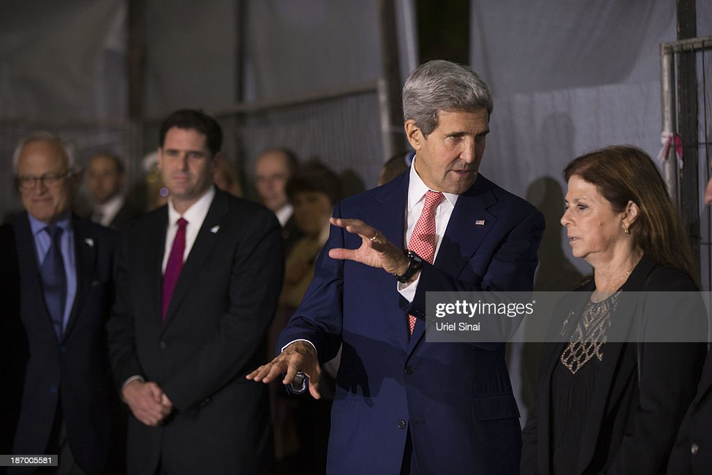 U.S. Secretary of State <a gi-track='captionPersonalityLinkClicked' href=/galleries/search?phrase=John+Kerry&family=editorial&specificpeople=154885 ng-click='$event.stopPropagation()'>John Kerry</a> (C) speaks with <a gi-track='captionPersonalityLinkClicked' href=/galleries/search?phrase=Dalia+Rabin-Pelossof&family=editorial&specificpeople=2575928 ng-click='$event.stopPropagation()'>Dalia Rabin-Pelossof</a> (L), daughter of assassinated Israeli Prime Minister Yitzhak Rabin, during a memorial service at the site Israel's former Prime Minister Yitzhak Rabin's assassination on November 05, 2013 in Tel Aviv, Israel. Kerry is in the region to meet with both the Isaeli and Palestinian leaders.