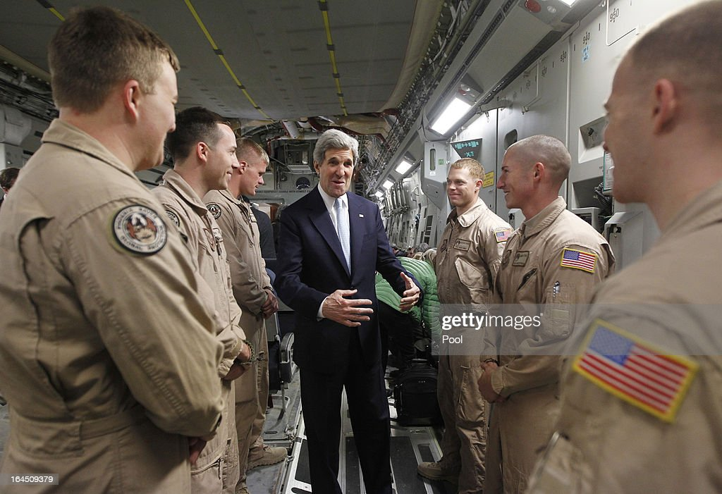 U.S. Secretary of State <a gi-track='captionPersonalityLinkClicked' href=/galleries/search?phrase=John+Kerry&family=editorial&specificpeople=154885 ng-click='$event.stopPropagation()'>John Kerry</a> speaks with members of the U.S. Air Force 816 Expeditionary Airlift Squadron aboard a C-17 aircraft bound for Baghdad on March 24, 2013 in Amman, Jordan. Kerry is expected to urge Iraqi Prime Minister Nuri al-Maliki during his visit to ensure that Iranian flights over Iraq do not carry arms and fighters to Syria.