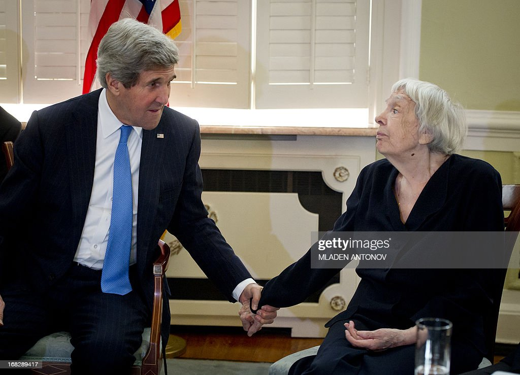 US Secretary of State John Kerry (L) speaks with Moscow Helsinki Group founder and chairwoman Lyudmila Alekseyeva during his meeting with Civil Society Representatives at Spaso House, the US Ambassador residence in Moscow, on May 8, 2013. Kerry arrived yesterday in Moscow for talks with Russian President Vladimir Putin, seeking to restore frayed US-Russia ties and win Moscow's support on the war in Syria. AFP PHOTO/POOL/MLADEN ANTONOV