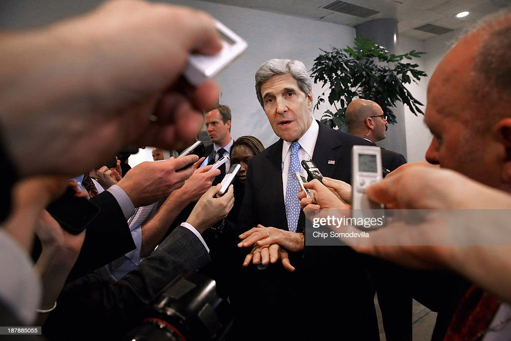 U.S. Secretary of State <a gi-track='captionPersonalityLinkClicked' href=/galleries/search?phrase=John+Kerry&family=editorial&specificpeople=154885 ng-click='$event.stopPropagation()'>John Kerry</a> speaks with reporters at the U.S. Capitol before testifying to the Senate Banking and Urban Affairs Committee behind closed doors November 13, 2013 in Washington, DC. Kerry is asking Congress not to approve any new sanctions on Iran while negotiations continue with Tehran about its nuclear program.