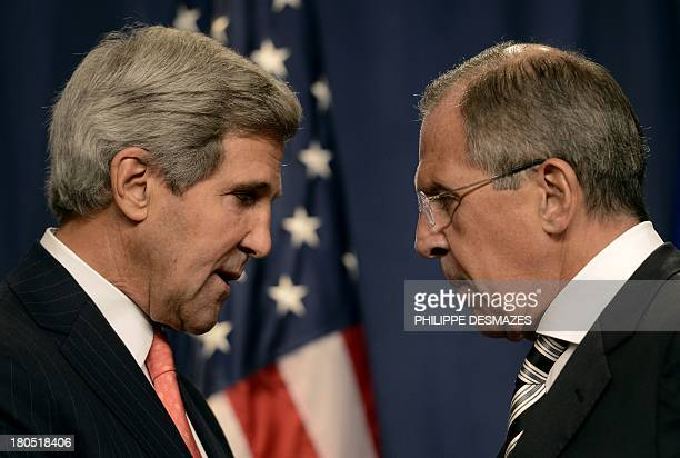 US Secretary of State John Kerry speaks with Russian Foreign Minister Sergey Lavrov before a press conference in Geneva on September 14 2013 after...