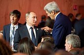 US Secretary of State John Kerry speaks with Russian President Vladimir Putin during the opening ceremony of the World Climate Change Conference 2015...