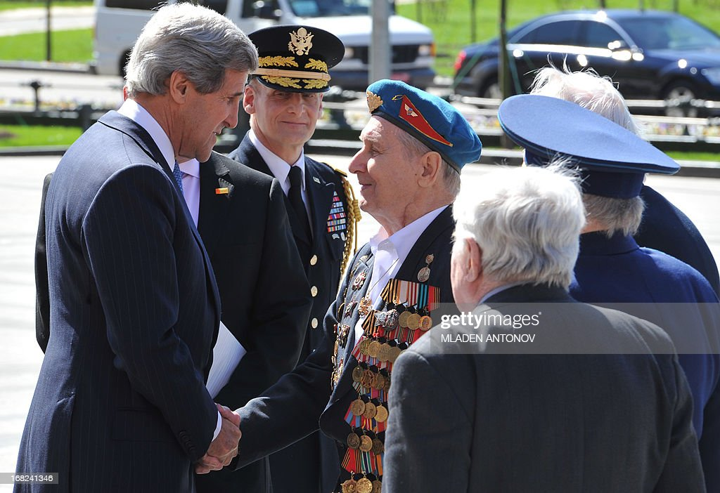 US Secretary of State John Kerry (L) speaks with Russian World War II veterans as he takes part in a wreath laying ceremony at the Tomb of the Unknown Soldier in Moscow, on May 7, 2013. Kerry arrived today in Moscow for talks with Russian President Vladimir Putin, seeking to restore frayed US-Russia ties and win Moscow's support on the war in Syria.