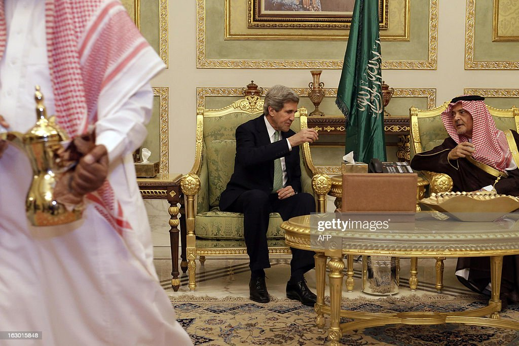 U.S. Secretary of State John Kerry (L), speaks with Saudi Foreign Minister Prince Saud al-Faisal upon his arrival in Riyadh, on March 3, 2013. Saudi Arabia is the seventh leg of Kerry's first official overseas trip. AFP PHOTO/JACQUELYN MARTIN-POOL