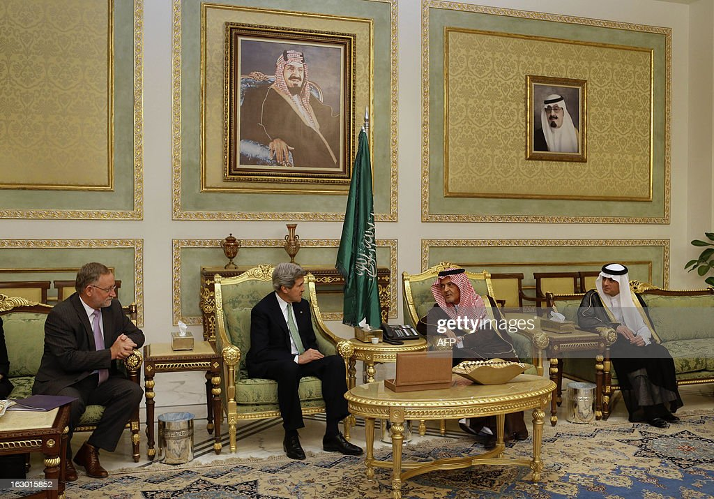 U.S. Secretary of State John Kerry (2nd L), speaks with Saudi Foreign Minister Prince Saud al-Faisal (2nd R) upon his arrival in Riyadh, on March 3, 2013. Saudi Arabia is the seventh leg of Kerry's first official overseas trip.