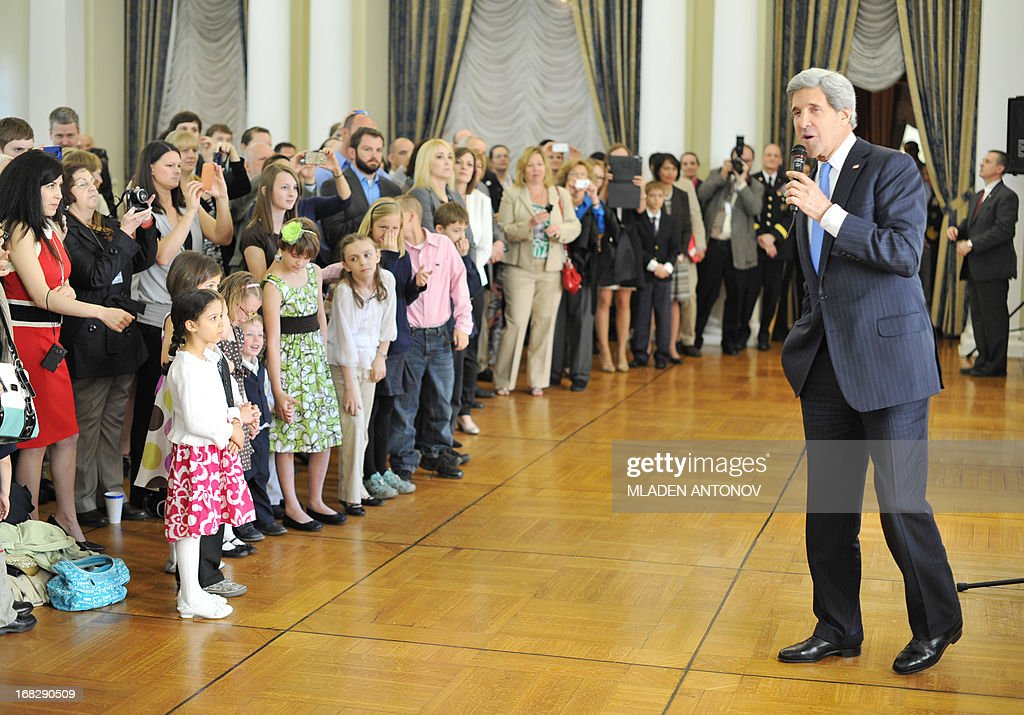 US Secretary of State John Kerry speaks with the US embassy staff members and their families during a 'meet and greet' event at Spaso House, the US Ambassador residence in Moscow, on May 8, 2013. Kerry arrived yesterday in Moscow for talks with Russian President Vladimir Putin, seeking to restore frayed US-Russia ties and win Moscow's support on the war in Syria. AFP PHOTO/POOL/MLADEN ANTONOV