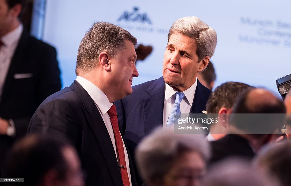 U.S. Secretary of State John Kerry (R) speaks with Ukrainian President Petro Poroshenko (L) during the 2016 Munich Security Conference at the Bayerischer Hof hotel on February 13, 2016 in Munich, Germany. The annual event brings together government representatives and security experts from across the globe and this year the conflict in Syria will be the main issue under discussion.