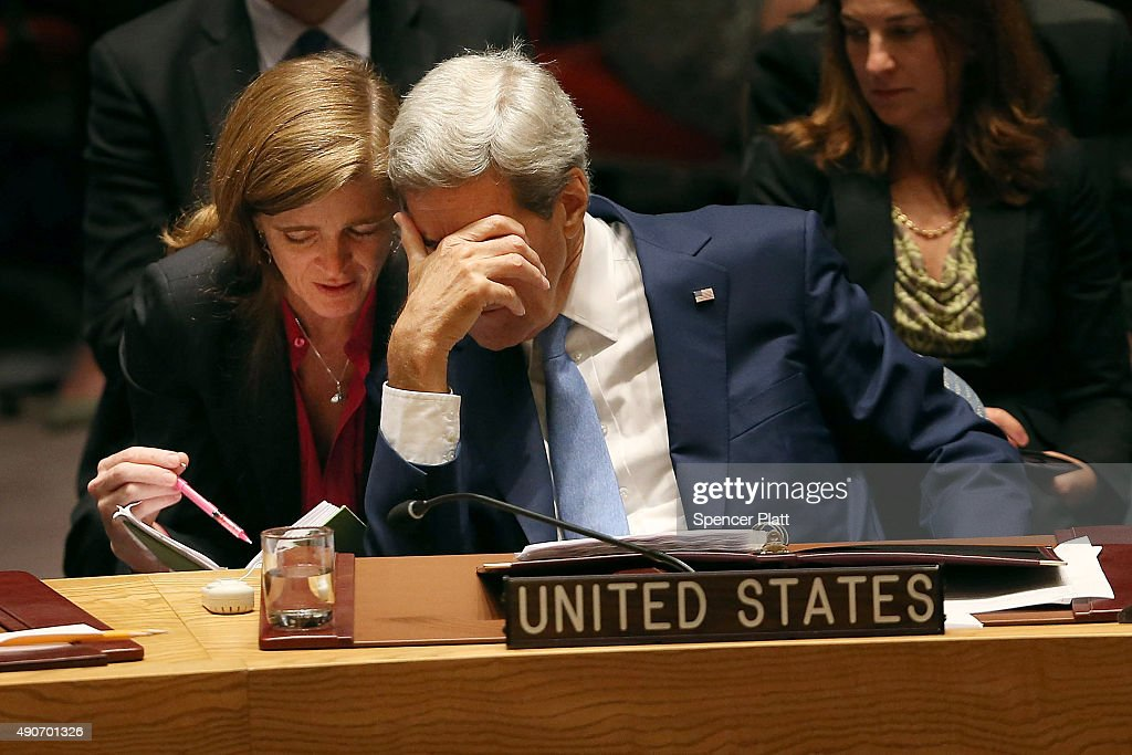 Secretary of State John Kerry speaks with United States Ambassador to the United Nations Samantha Power at a Security Council meeting on counter...