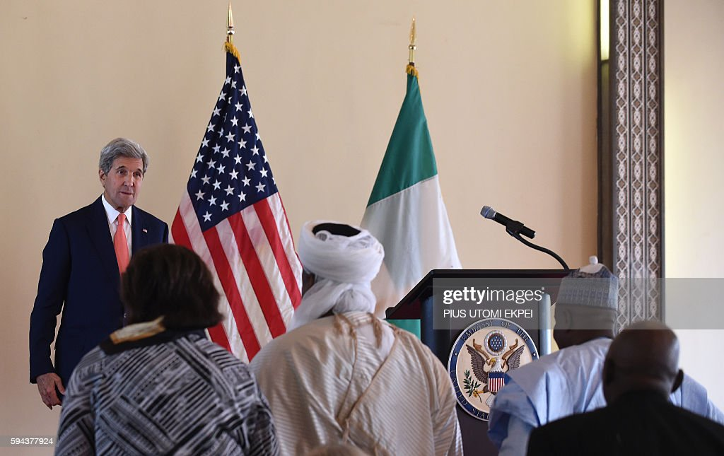 US Secretary of State John Kerry stands as he delivers a speech on 'the importance of resilient communities and religious tolerance in countering...