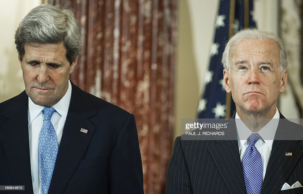 US Secretary of State John Kerry (L) stands with US Vice President Joe Biden(R) as an invocation is recited during Kerry's ceremonial swearing-in as US Secretary of State on February 6, 2013 at US State Department in Washington, DC. AFP PHOTO/Paul J. Richards