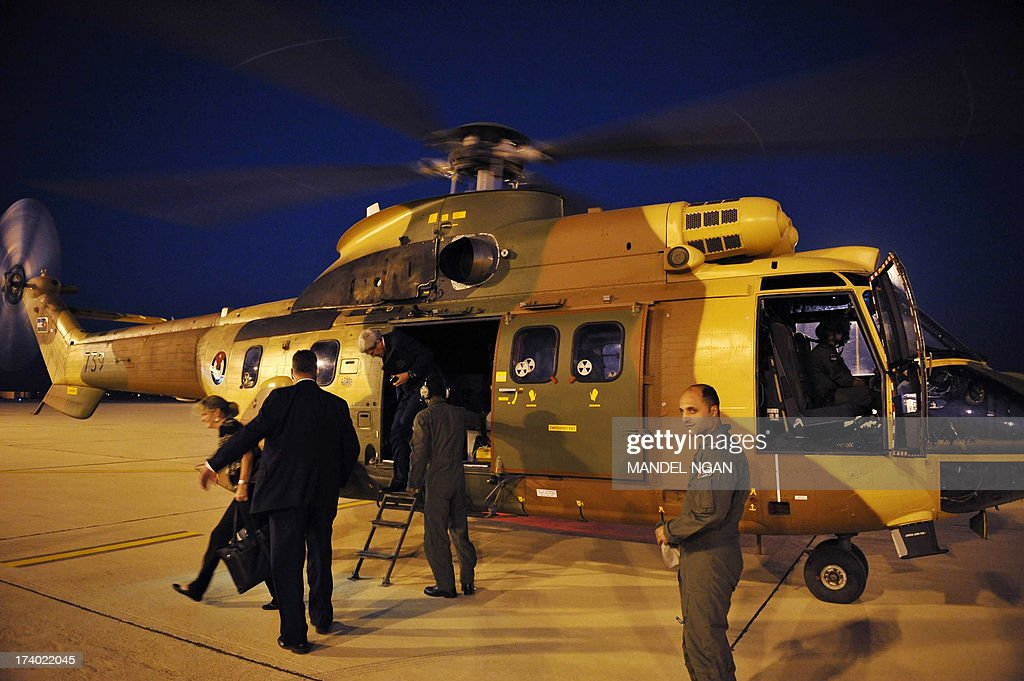 US Secretary of State John Kerry steps out of a helicopter upon his arrival at Queen Alia International Airport in Amman on July 19, 2013, back from the West Bank city of Ramallah. Kerry flew by helicopter to the West Bank from Jordan to meet Palestinian president Mahmud Abbas as he battled to salvage his Middle East peace bid.