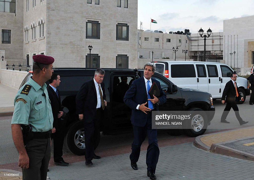 US Secretary of State John Kerry steps out of a SUV as he prepares to depart from the Mukataa following a meeting with Palestinian President Mahmud Abbas on July 19, 2013 in the West Bank city of Ramallah. Kerry flew by helicopter to the West Bank from Jordan to meet Palestinian president Mahmud Abbas as he battled to salvage his Middle East peace bid.