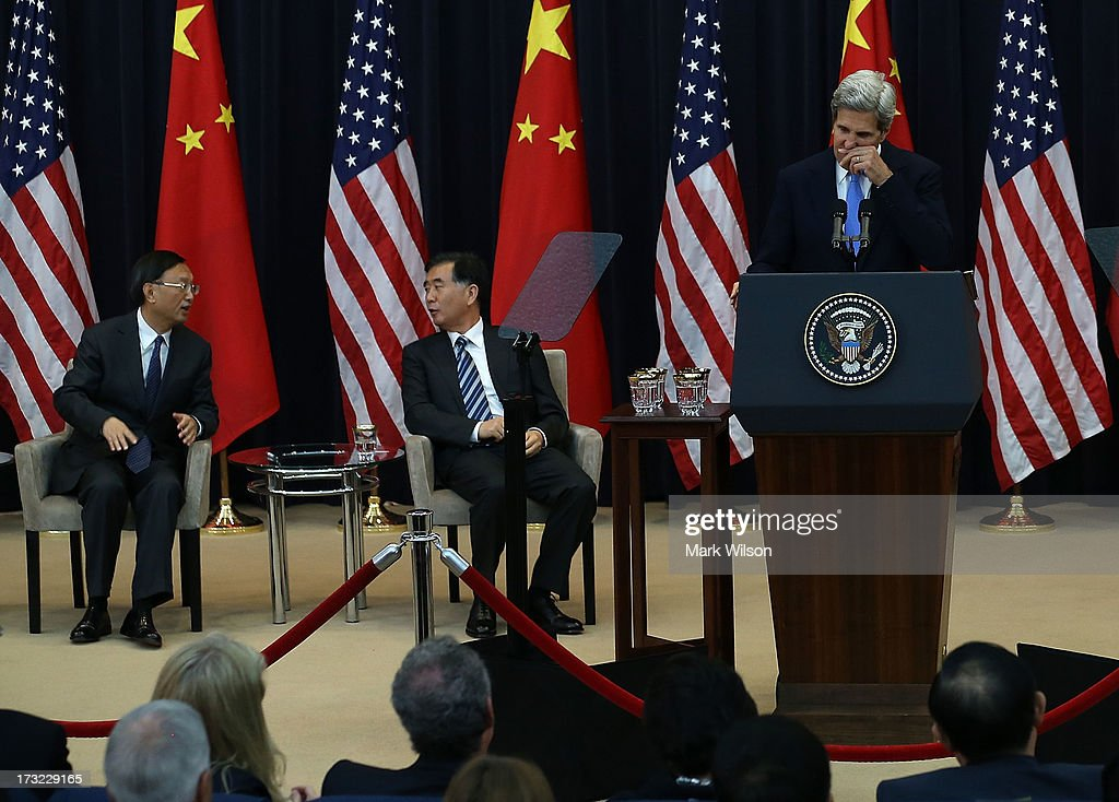 U.S. Secretary of State John Kerry (C) talks about the health of his wife Teresa Heinz Kerry, who is in the hospital, while Chinese State Councilor Yang Jiechi (L), Chinese Vice Premier Wang Qishan (2nd-L), listen during the opening session of the U.S. and China Strategic and Economic Dialogue at the U.S. Department of State July 10, 2013 in Washington, DC. Officials from the United States and China are meeting in Washington for the 5th U.S. and China Strategic and Economic Dialogue.