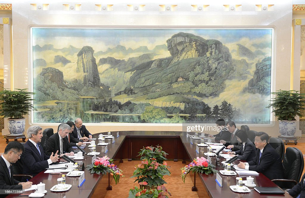U.S. Secretary of State John Kerry (2nd L) talks with Chinese President Xi Jinping (R) during their meeting at the Great Hall of the People in Beijing on April 13, 2013. The U.S. Secretary is on a tour of Asia, visiting South Korea, Japan and China to discuss issues concerning North Korea.