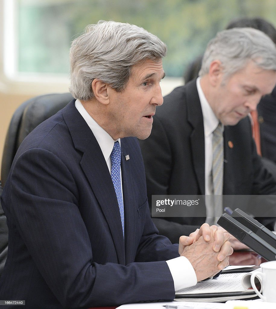U.S. Secretary of State John Kerry (L) talks with Chinese President Xi Jinping during their meeting at the Great Hall of the People in Beijing on April 13, 2013. The U.S. Secretary is on a tour of Asia, visiting South Korea, Japan and China to discuss issues concerning North Korea.