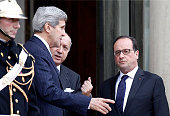 Secretary of State John Kerry talks with French President Francois Hollande and Laurent Fabius French Minister of Foreign Affairs and International...