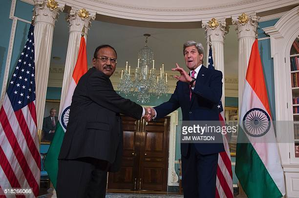 US Secretary of State John Kerry talks with Indian National Security Advisor Ajit Doval at the State Department in Washington DC March 30 2016 / AFP...