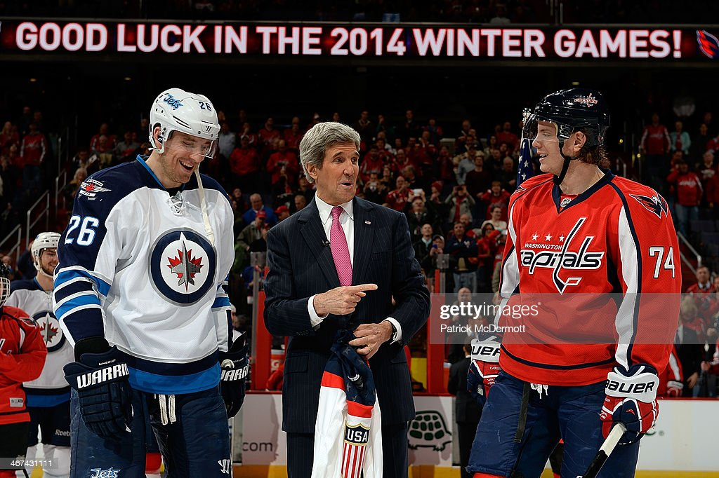 U.S. Secretary of State <a gi-track='captionPersonalityLinkClicked' href=/galleries/search?phrase=John+Kerry&family=editorial&specificpeople=154885 ng-click='$event.stopPropagation()'>John Kerry</a> talks with Olympians John Carlson #74 of the Washington Capitals and <a gi-track='captionPersonalityLinkClicked' href=/galleries/search?phrase=Blake+Wheeler&family=editorial&specificpeople=716703 ng-click='$event.stopPropagation()'>Blake Wheeler</a> #26 of the Winnipeg Jets during a ceremonial puck drop before an NHL game at Verizon Center on February 6, 2014 in Washington, DC.