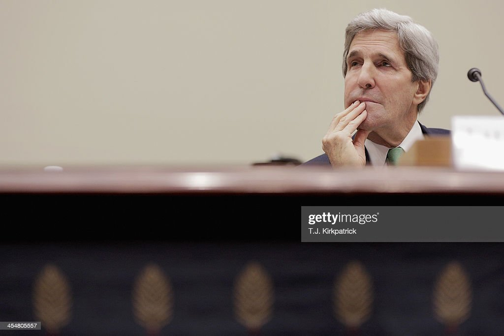 Secretary of State <a gi-track='captionPersonalityLinkClicked' href=/galleries/search?phrase=John+Kerry&family=editorial&specificpeople=154885 ng-click='$event.stopPropagation()'>John Kerry</a> testifies before the House Foreign Affairs Committee on December 10, 2013 in Washington, DC. During his testimony Secretary Kerry asked on behalf of the Obama Administration that congress hold off on sanctioning Iran to give diplomacy a chance to work its course.