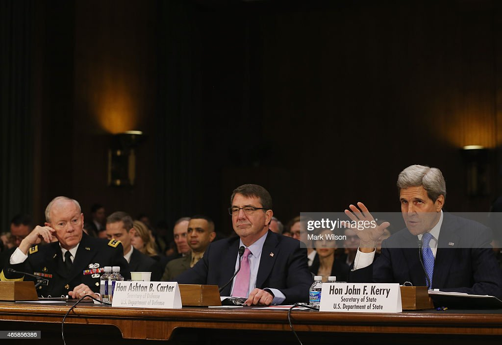 Secretary of State John Kerry (R) testifies while flanked by Defense Secretary Ashton Carter (C) and Chairman of the Joint Chiefs of Staff Gen. Martin Dempsey (L) during a Senate Foreign Relations Committee hearing on Capitol Hill, March 11, 2015 in Washington, DC. The committee is hearing testimony from top administration officials on President Obamas request to Congress for authorization to use force against ISIS.