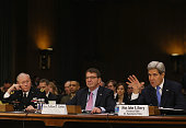 Secretary of State John Kerry testifies while flanked by Defense Secretary Ashton Carter and Chairman of the Joint Chiefs of Staff Gen Martin Dempsey...