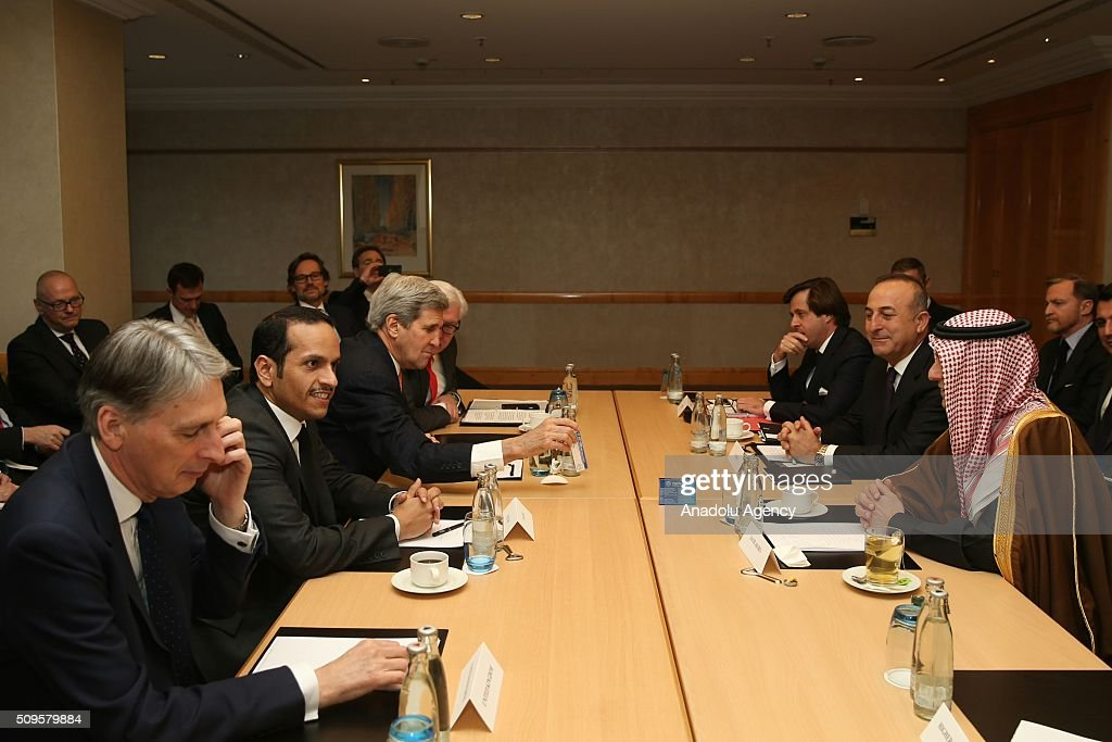 US Secretary of State John Kerry (L 3), Turkish Foreign Minister Mevlut Cavusoglu (R 2), Qatar's Foreign Minister Sheikh Mohammed bin Abdulrahman bin Jassim Al-Thani (L 2), British Foreign Minister Philip Hammond (L) and Saudi Arabian Foreign Minister Adel Al-Jubeir (R) are seen during International Syrian Support Group Meeting in Munich, Germany on February 11, 2016.