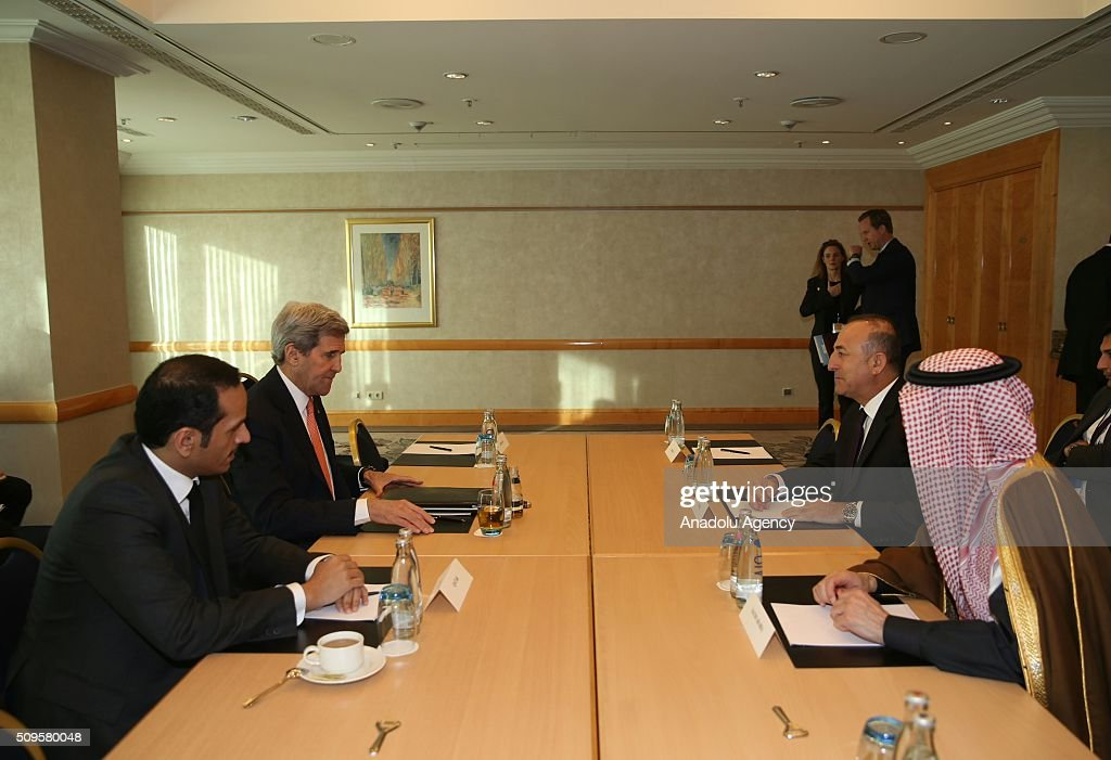 US Secretary of State John Kerry (L 2), Turkish Foreign Minister Mevlut Cavusoglu (R 2), Qatar's Foreign Minister Sheikh Mohammed bin Abdulrahman bin Jassim Al-Thani (L) and Saudi Arabian Foreign Minister Adel Al-Jubeir (R) are seen during International Syrian Support Group Meeting in Munich, Germany on February 11, 2016.