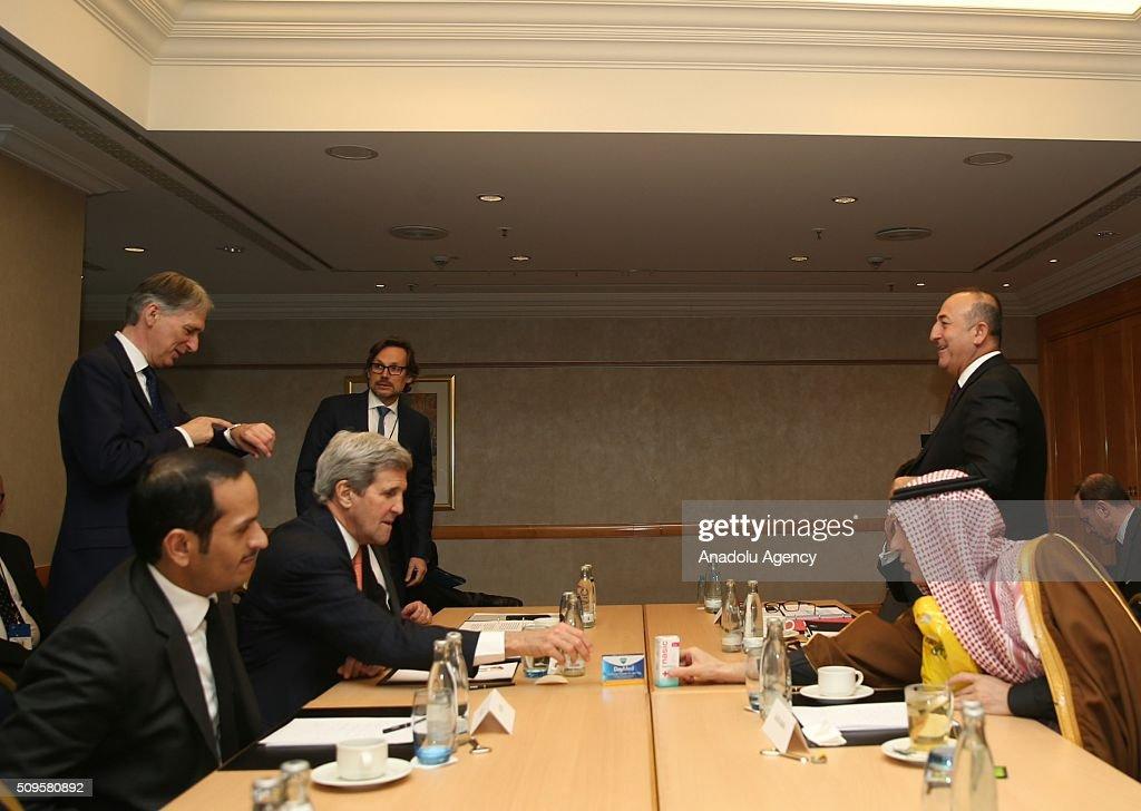 US Secretary of State John Kerry (L 2), Turkish Foreign Minister Mevlut Cavusoglu (R 2), Qatar's Foreign Minister Sheikh Mohammed bin Abdulrahman bin Jassim Al-Thani (L) and Saudi Arabian Foreign Minister Adel Al-Jubeir (R) are seen during International Syrian Support Group Meeting in Munich, Germany on February 11, 2016.
