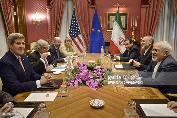 US Secretary of State John Kerry US Secretary of Energy Ernest Moniz the head of the Iranian Atomic Energy Organization Ali Akbar Salehi and Iranian...