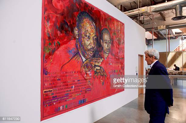 US Secretary of State John Kerry viewing a painting of Martin Luther King Jr at Facebook headquarters Menlo Park California June 23 2016 Image...